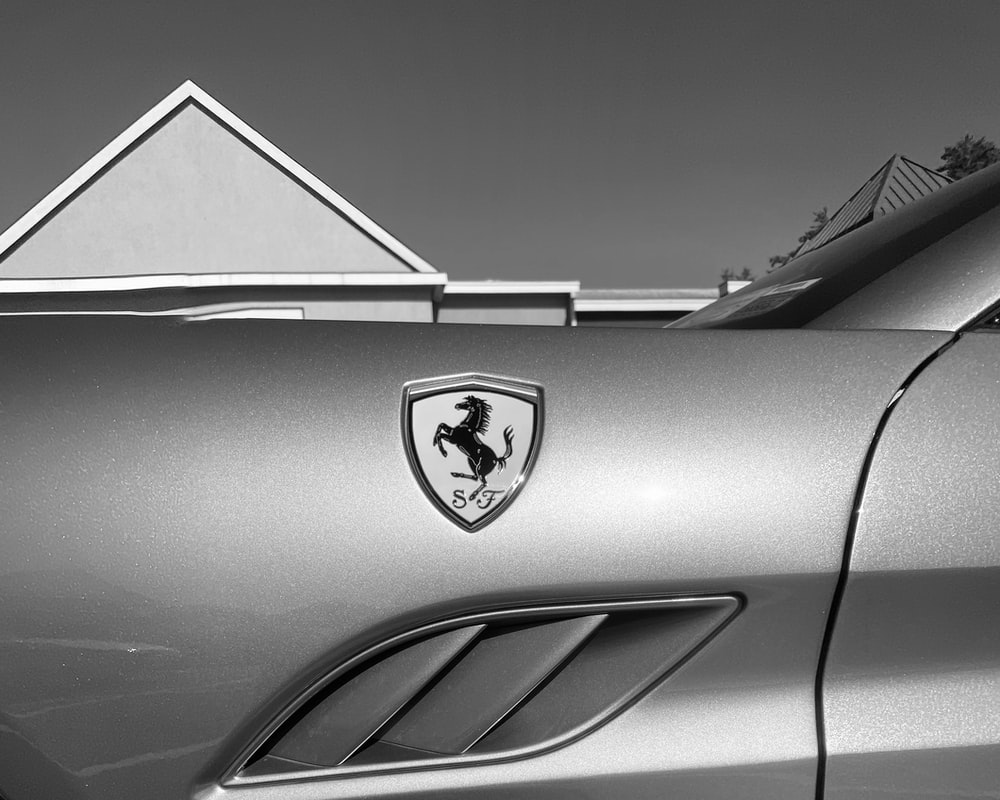 grayscale photo of car with logo