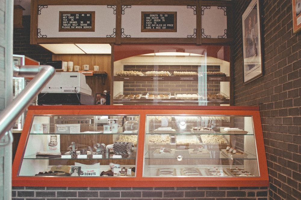 brown wooden framed glass display counter