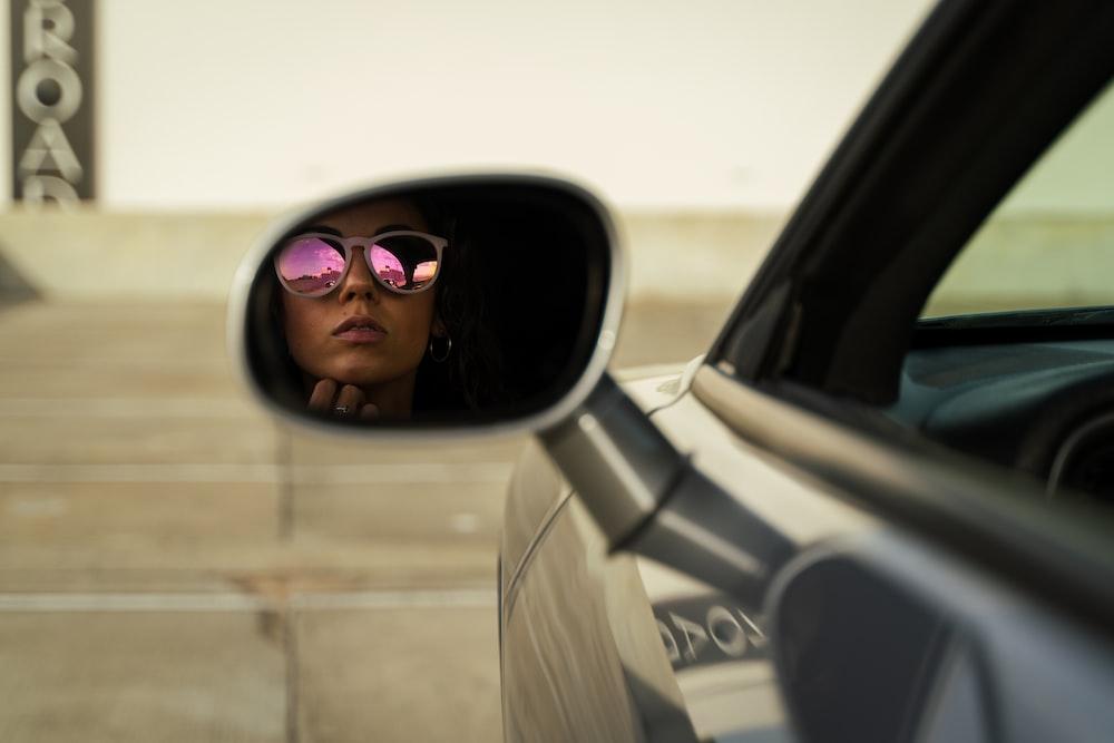 woman in white coat wearing sunglasses