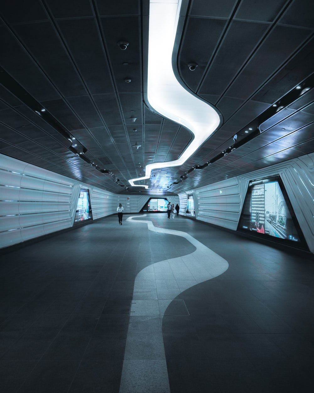 white and black tunnel with white lights