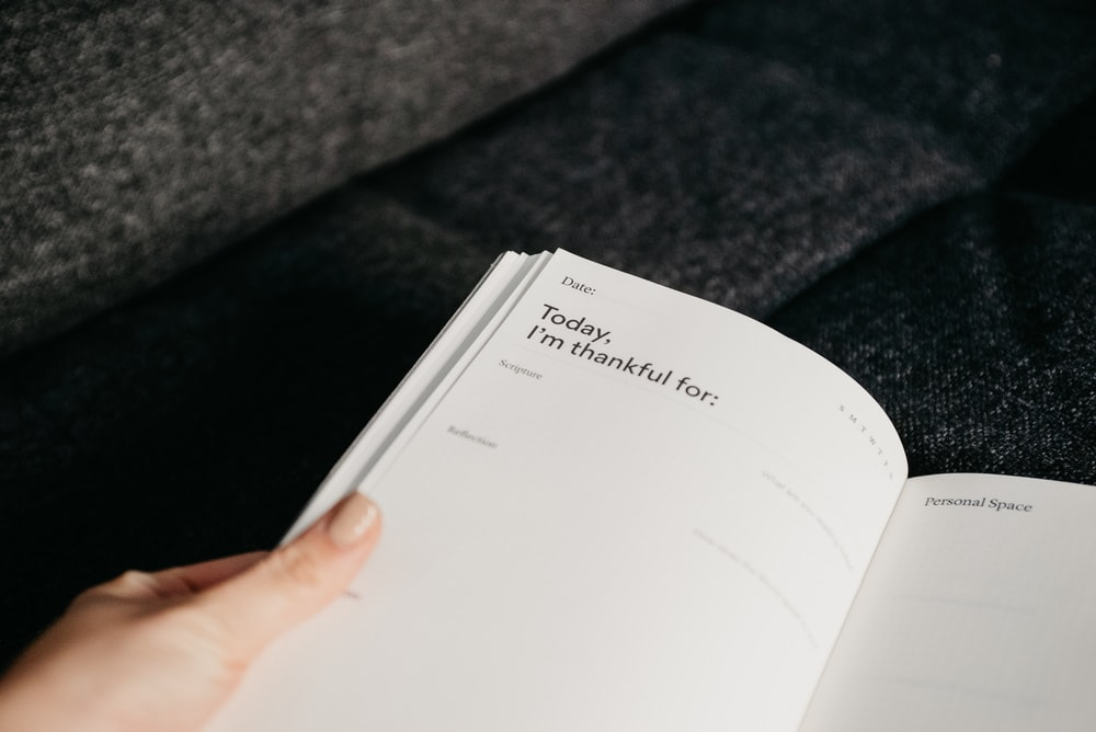 white printer paper on black textile