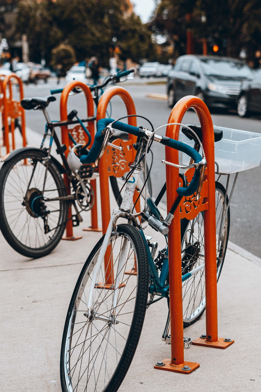orange city bike on road during daytime
