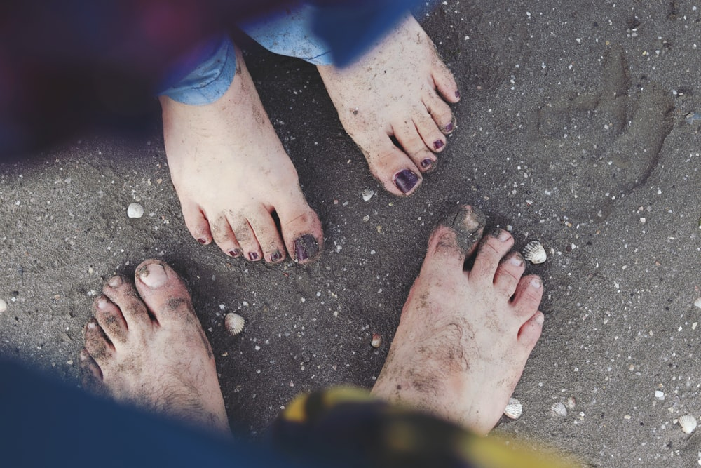 persons feet with red pedicure