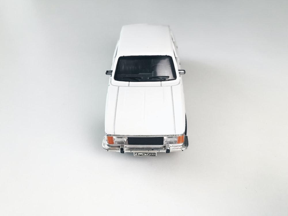 white car in white room