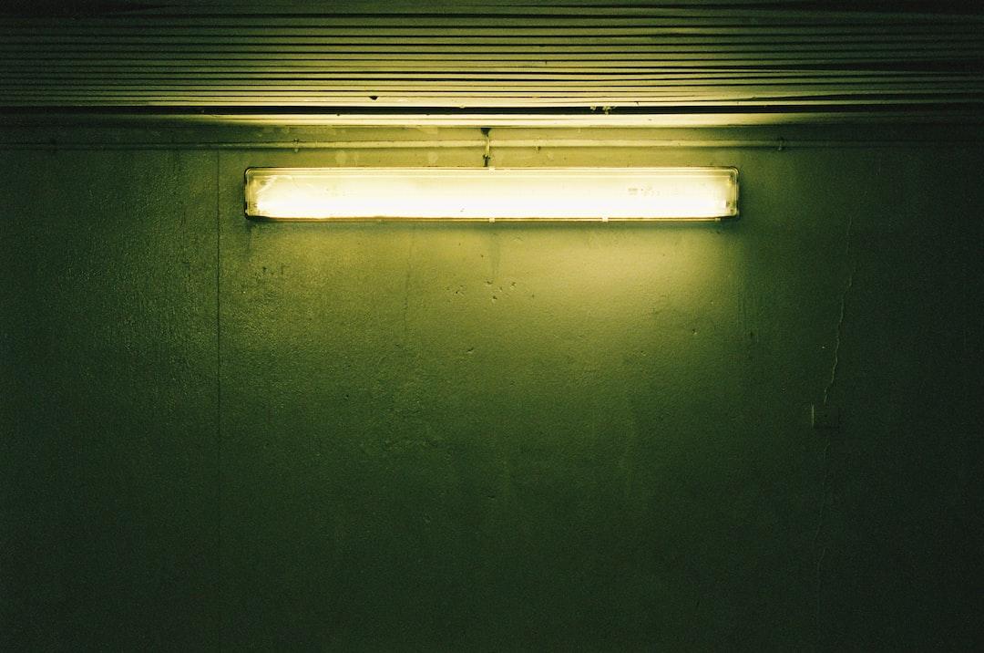 White Fluorescent Light Turned On On Black Wall - unsplash