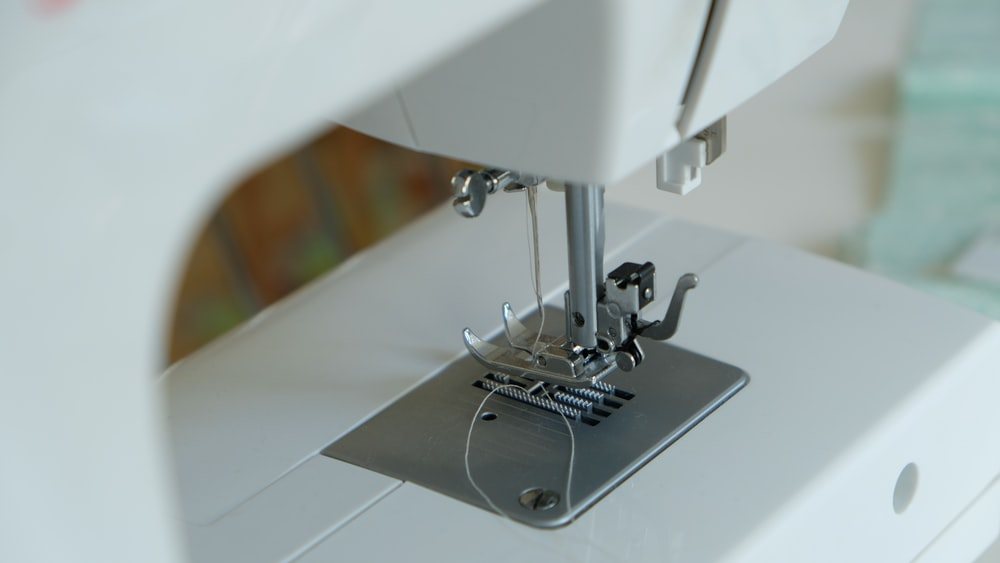 white sewing machine on table