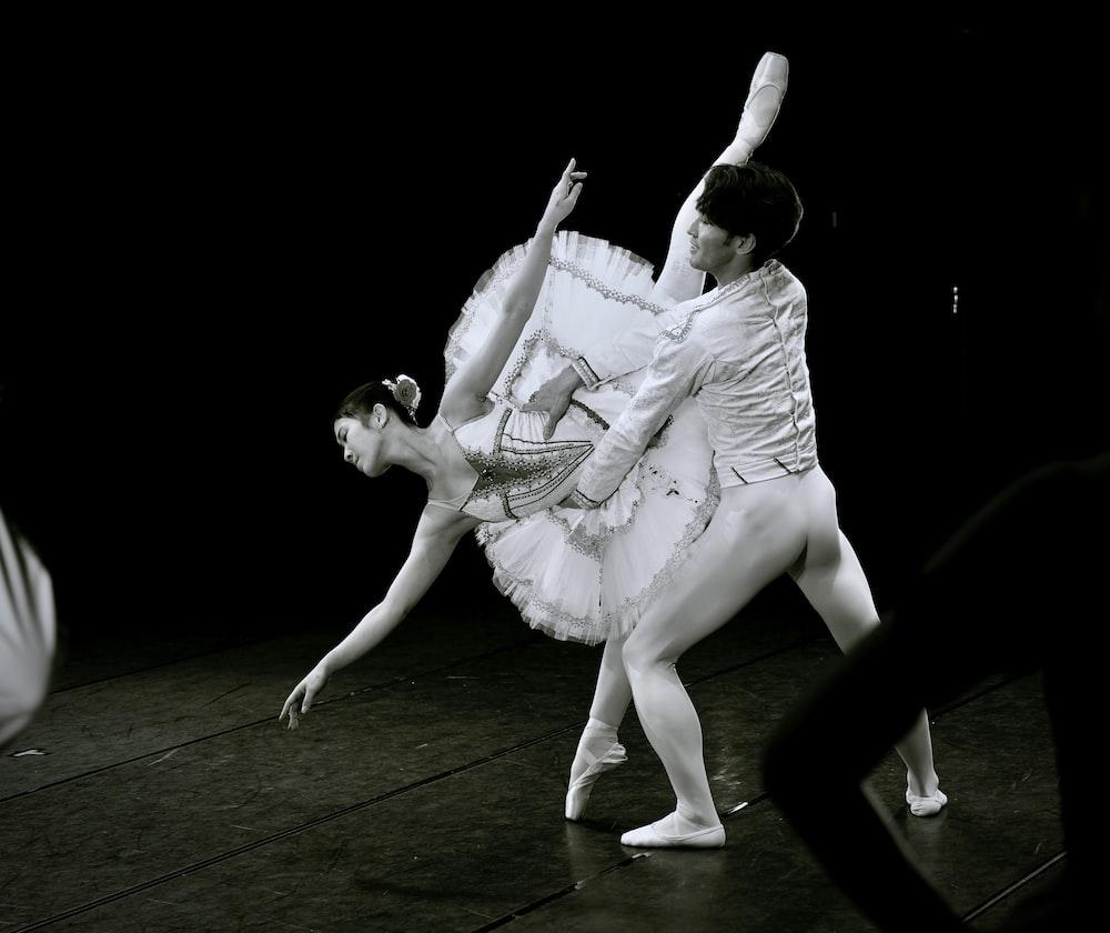 man in white dress shirt dancing