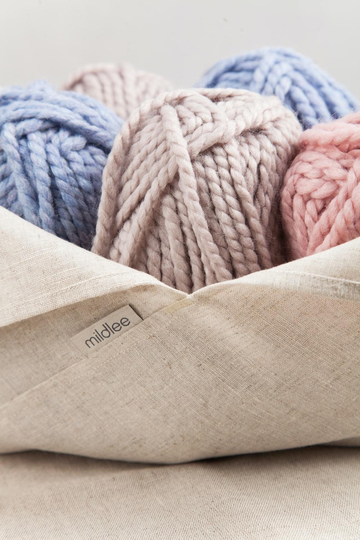 blue yarn on brown textile