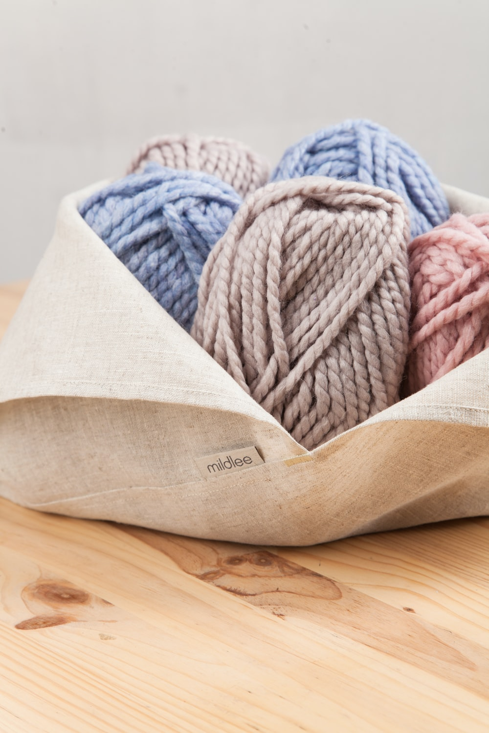 blue and white yarn on brown wooden table