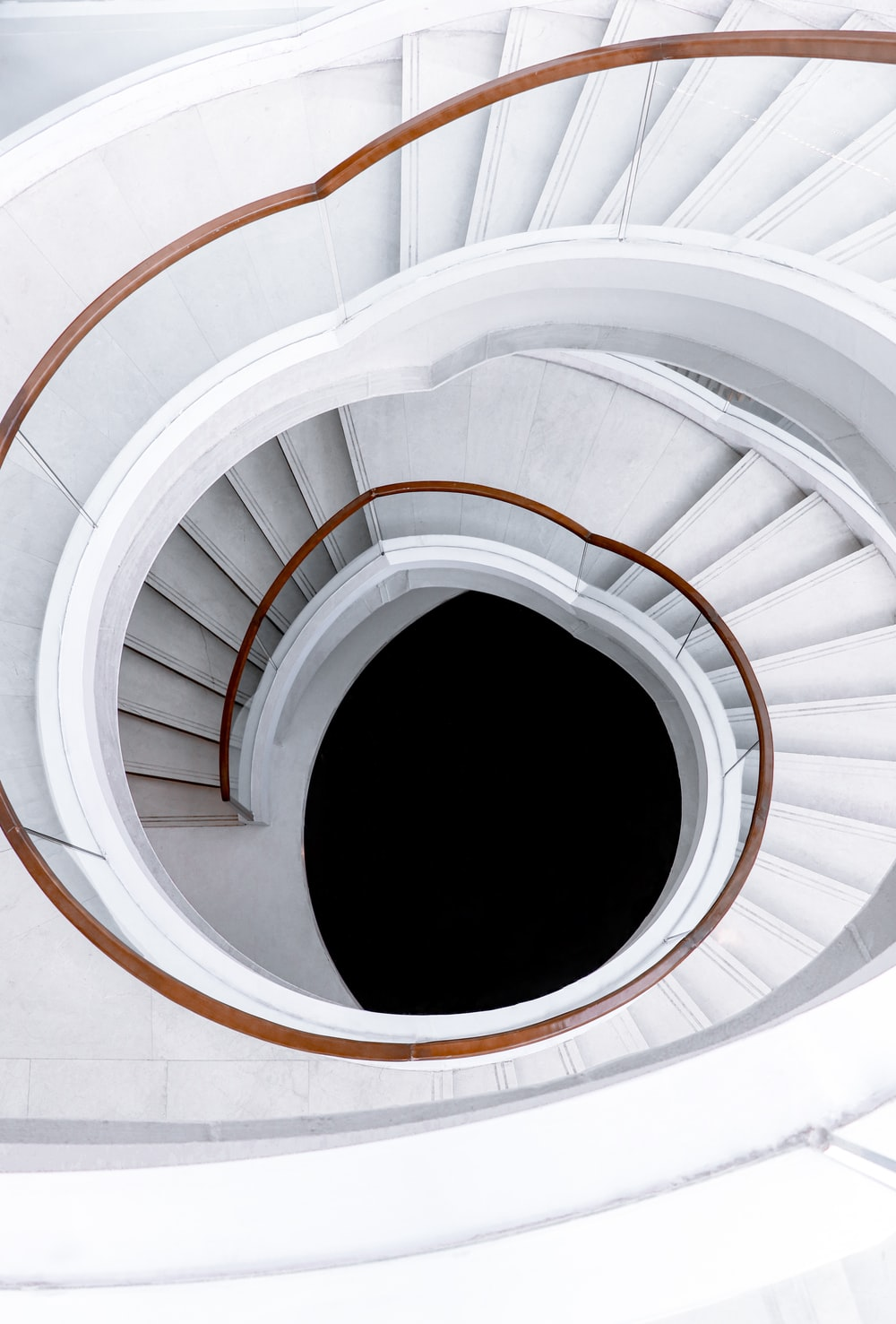 white spiral staircase with white metal railings