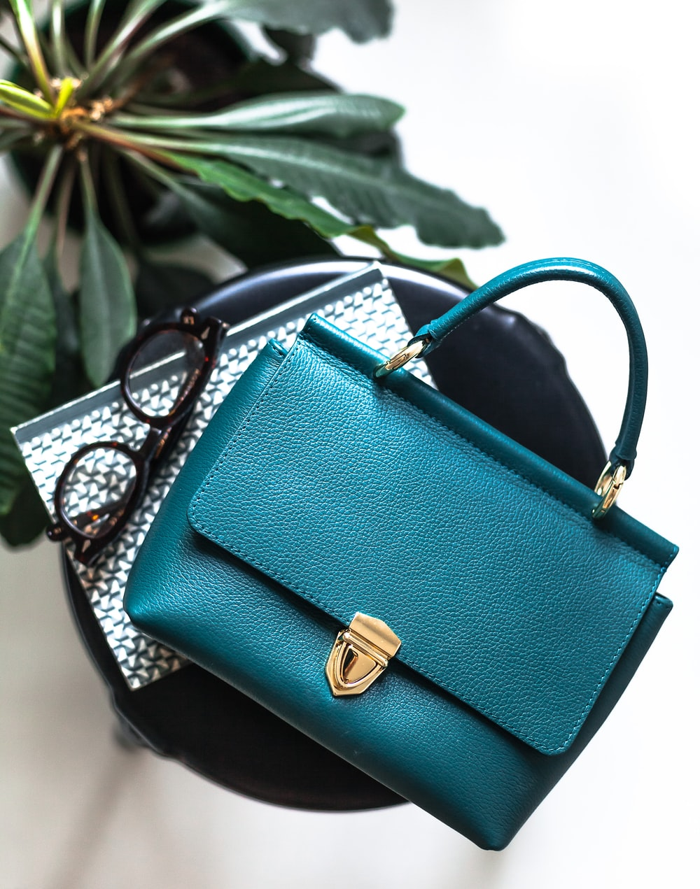blue leather handbag on black leather bag