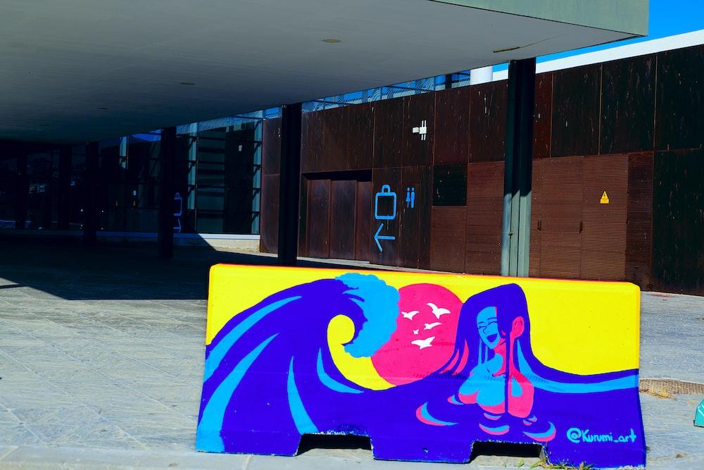 purple and yellow wall graffiti