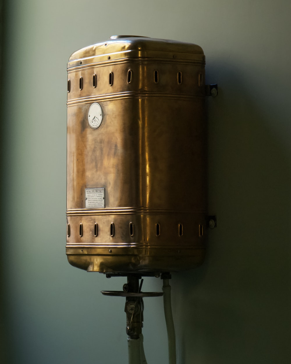 brown steel container on white wall