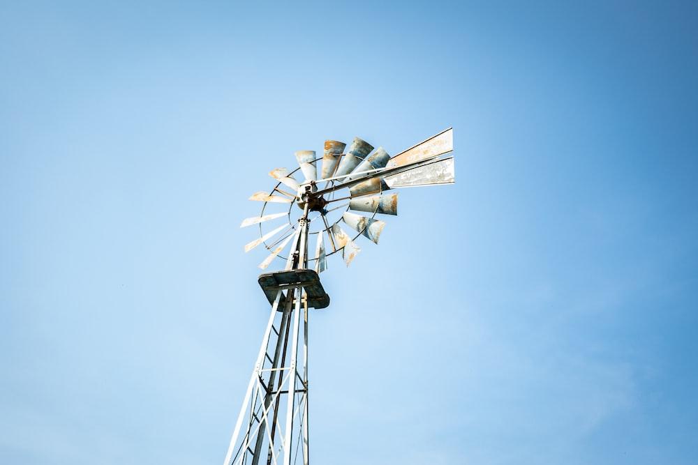 white wind mill under blue sky during daytime