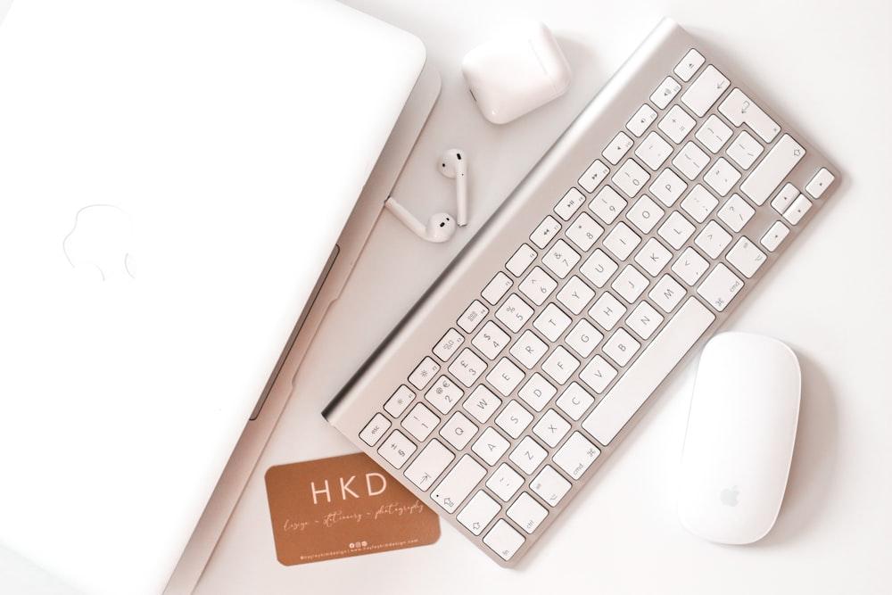 white apple keyboard beside white apple magic mouse