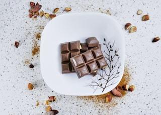 chocolate bar on white ceramic plate
