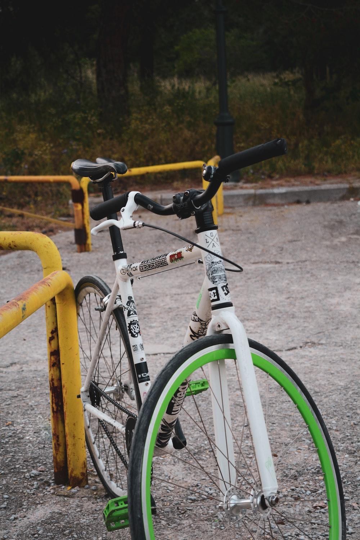 yellow and black bicycle on yellow metal railings