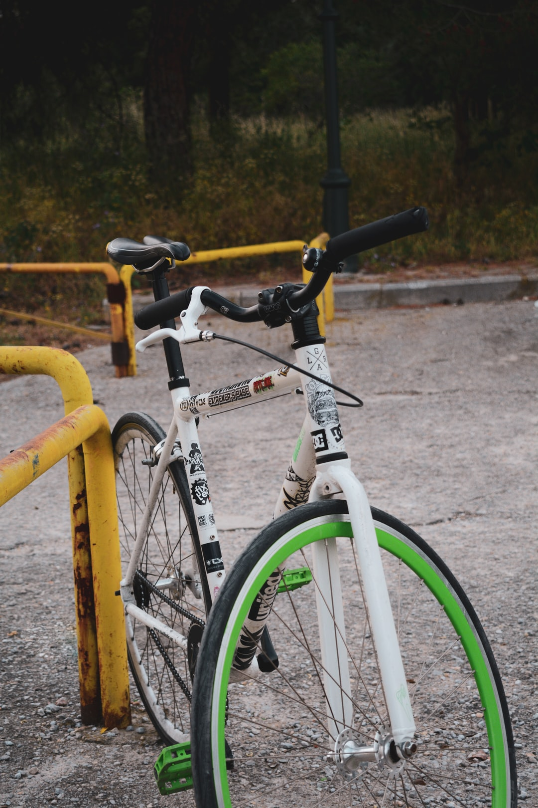 A Ballistic Fix bike - White and Green color with many stickers.