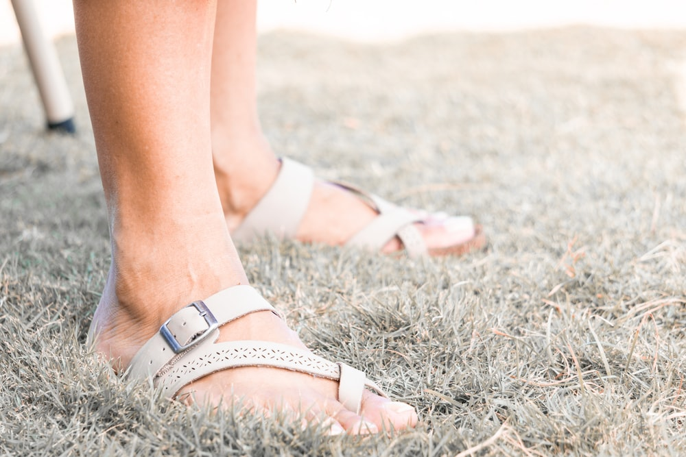 woman in white leather sandals