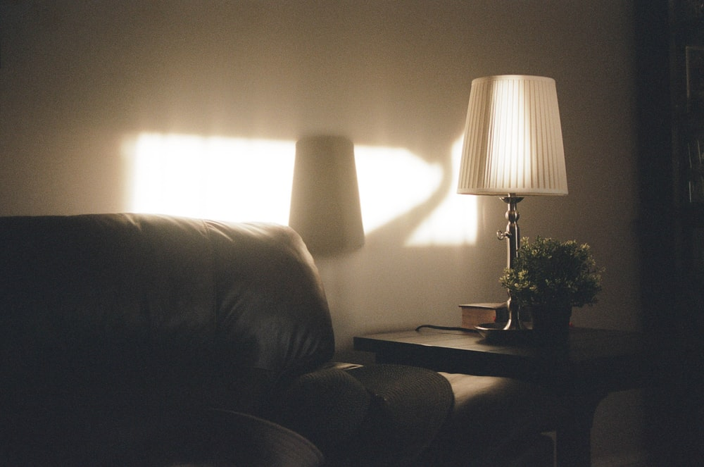 white table lamp on brown wooden table