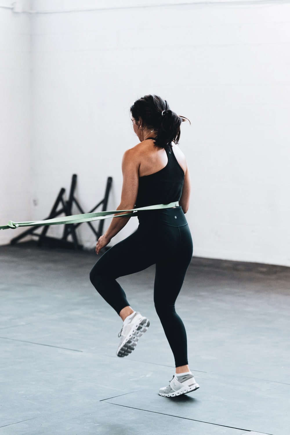 woman in black tank top and leggings doing exercise