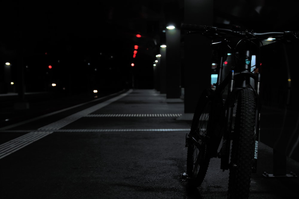 black motorcycle on road during night time