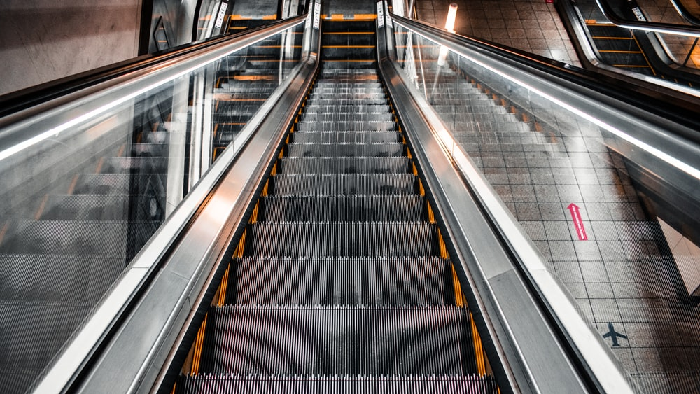 black and silver escalator with no people