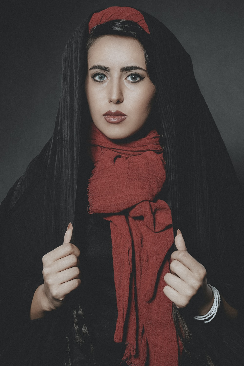 woman in red hijab and black long sleeve shirt