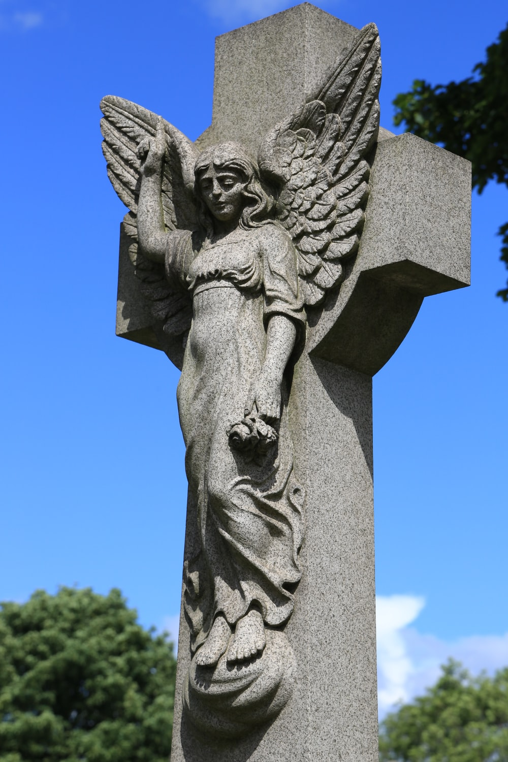 gray concrete angel statue during daytime