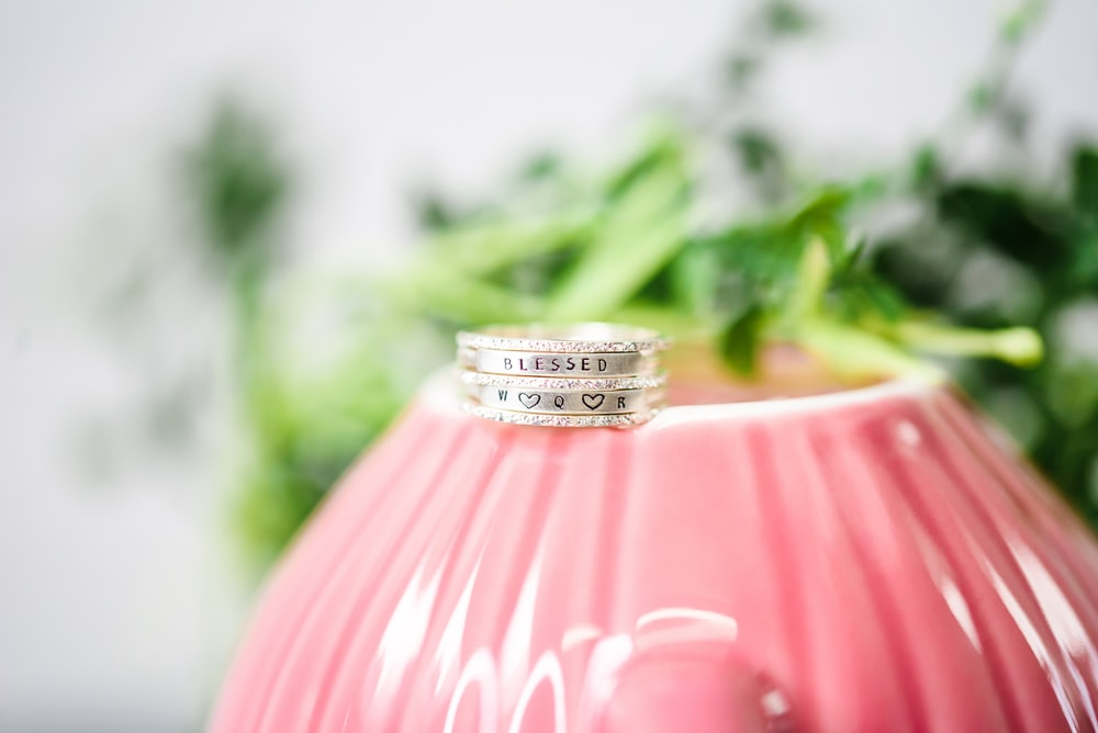 silver ring on pink lamp