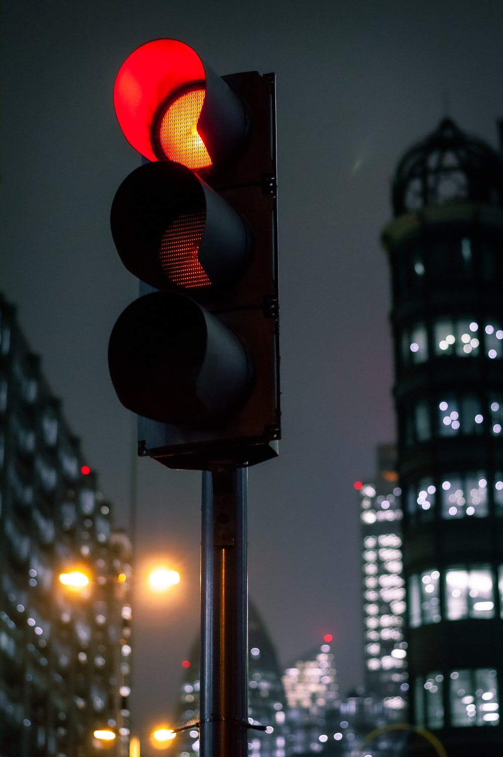 traffic light with red light during night time