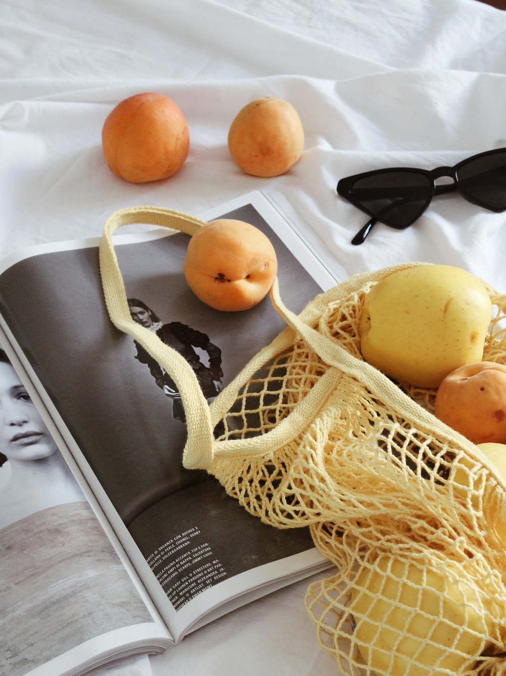 black sunglasses beside orange fruit