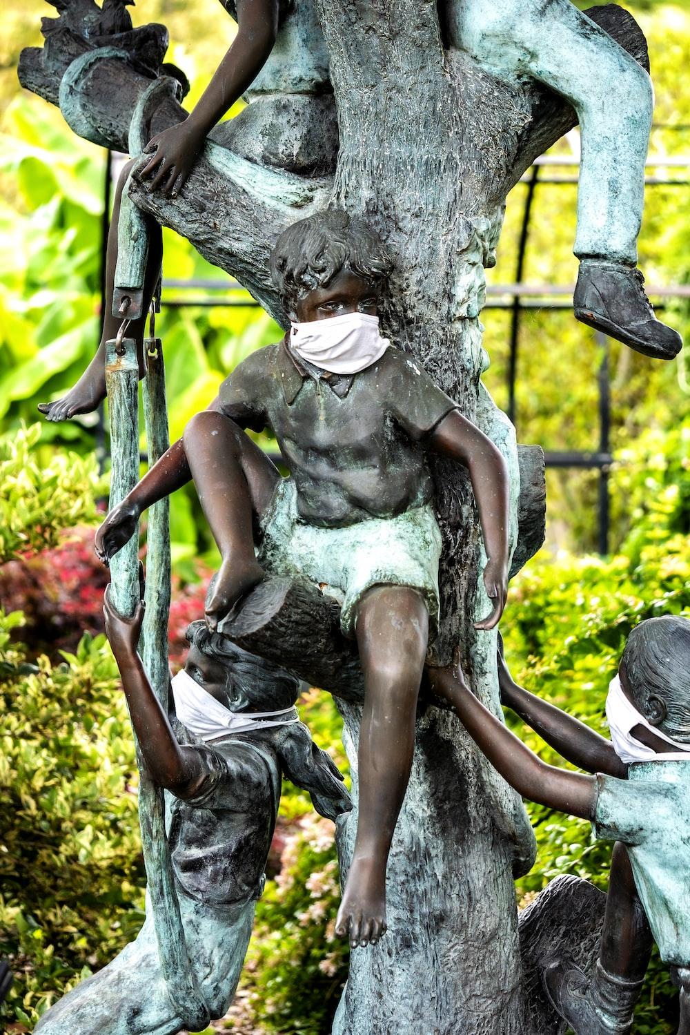 man in black tank top statue