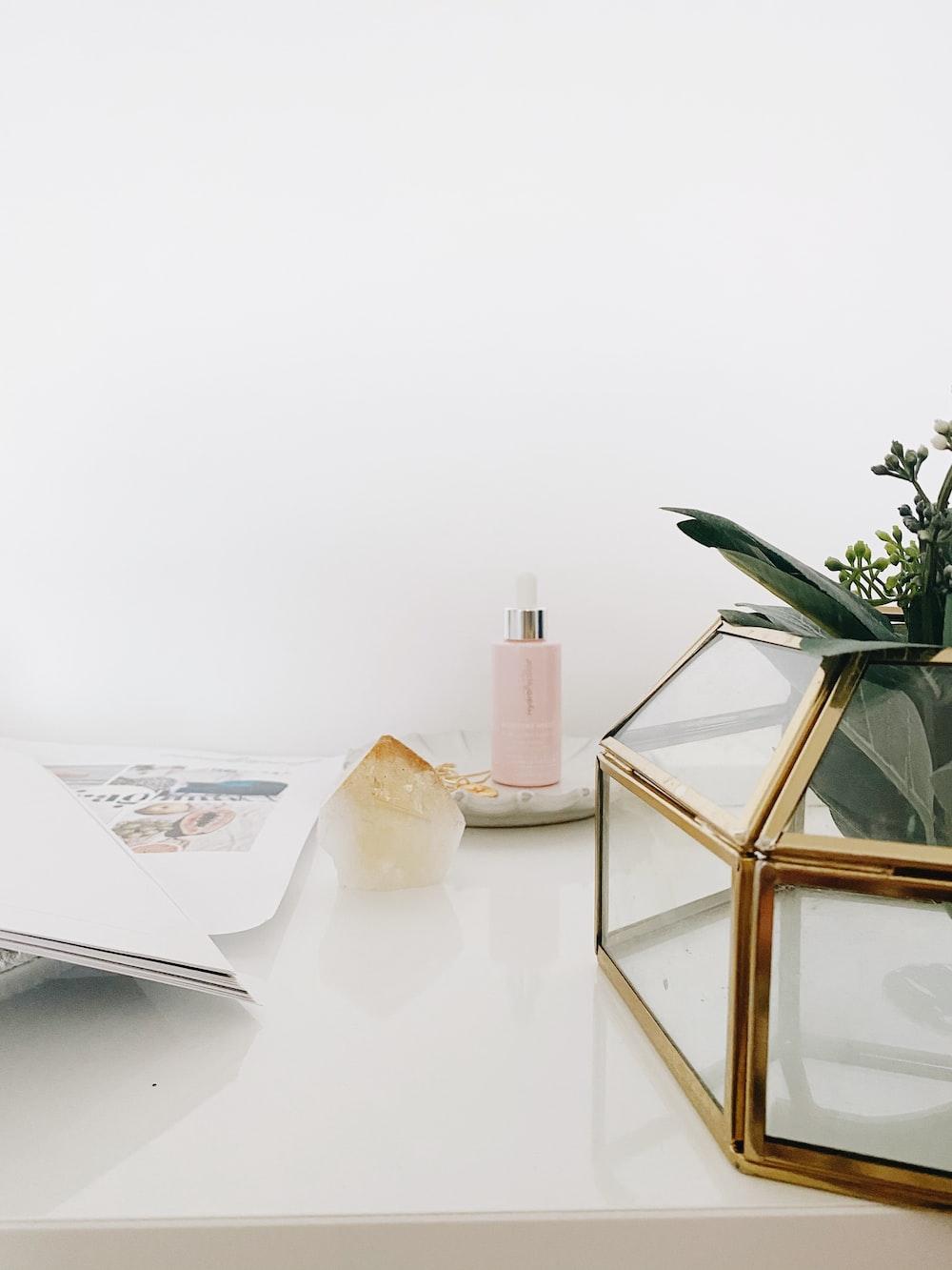 gold framed mirror on white table