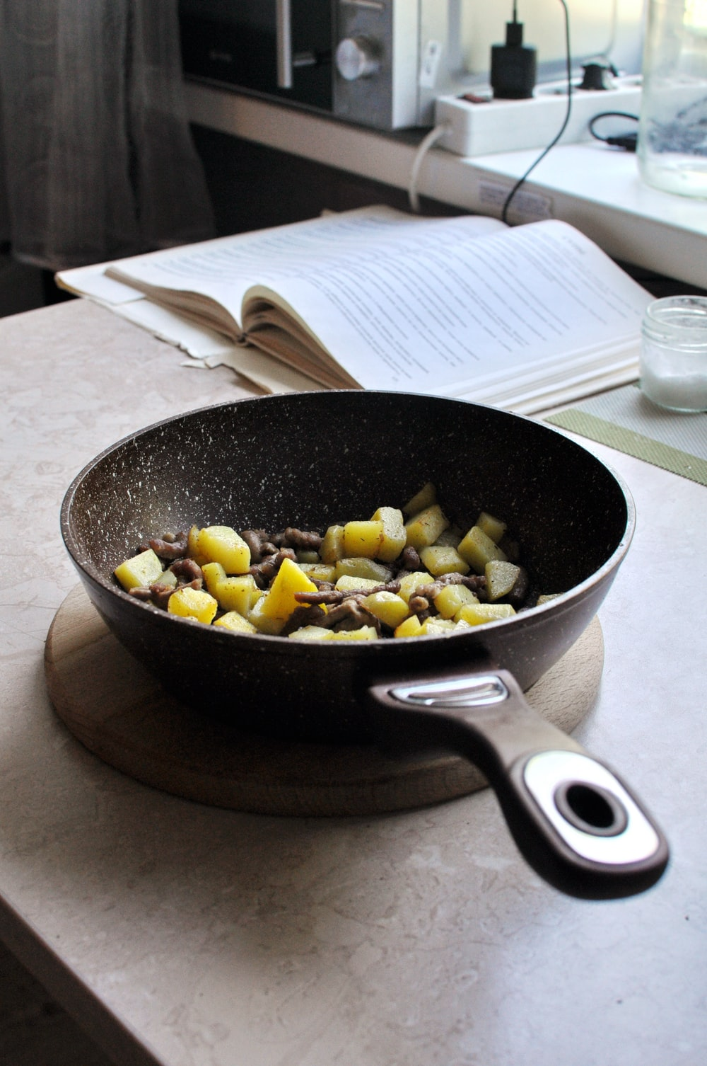 black frying pan with yellow and brown food