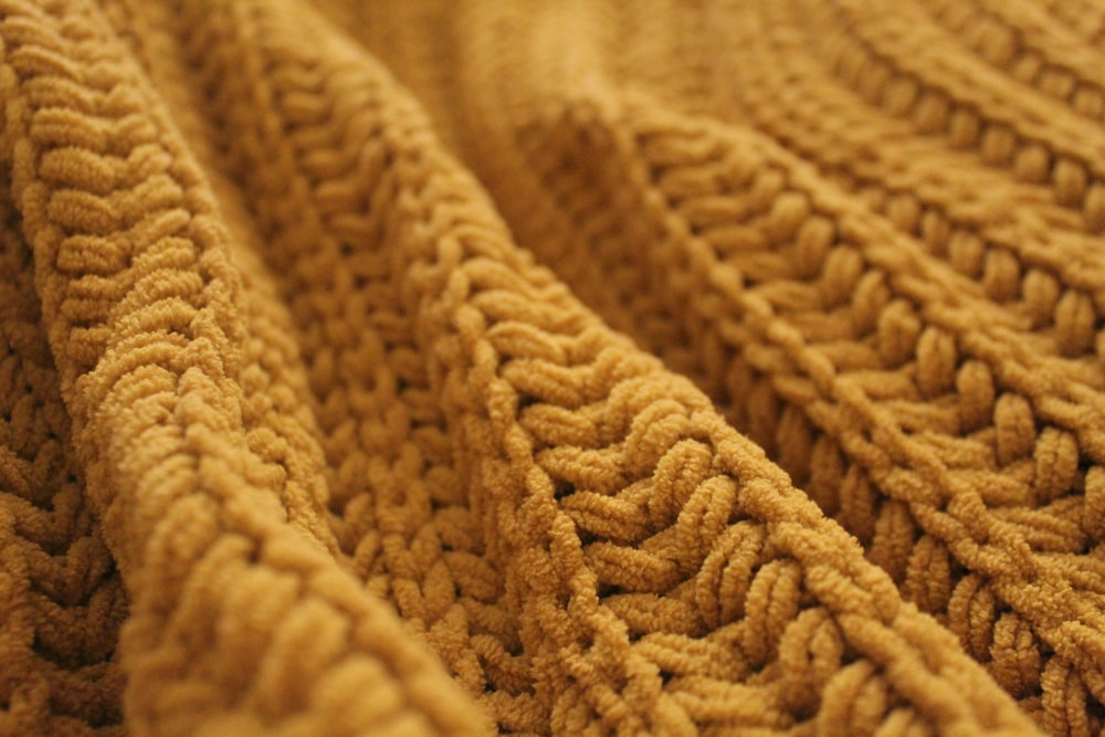 brown knit textile in close up photography