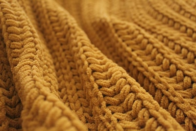 brown knit textile in close up photography knitting zoom background