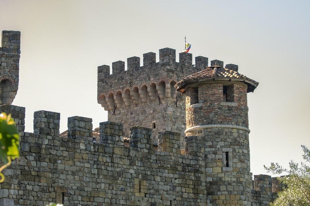 brown brick castle under gray sky
