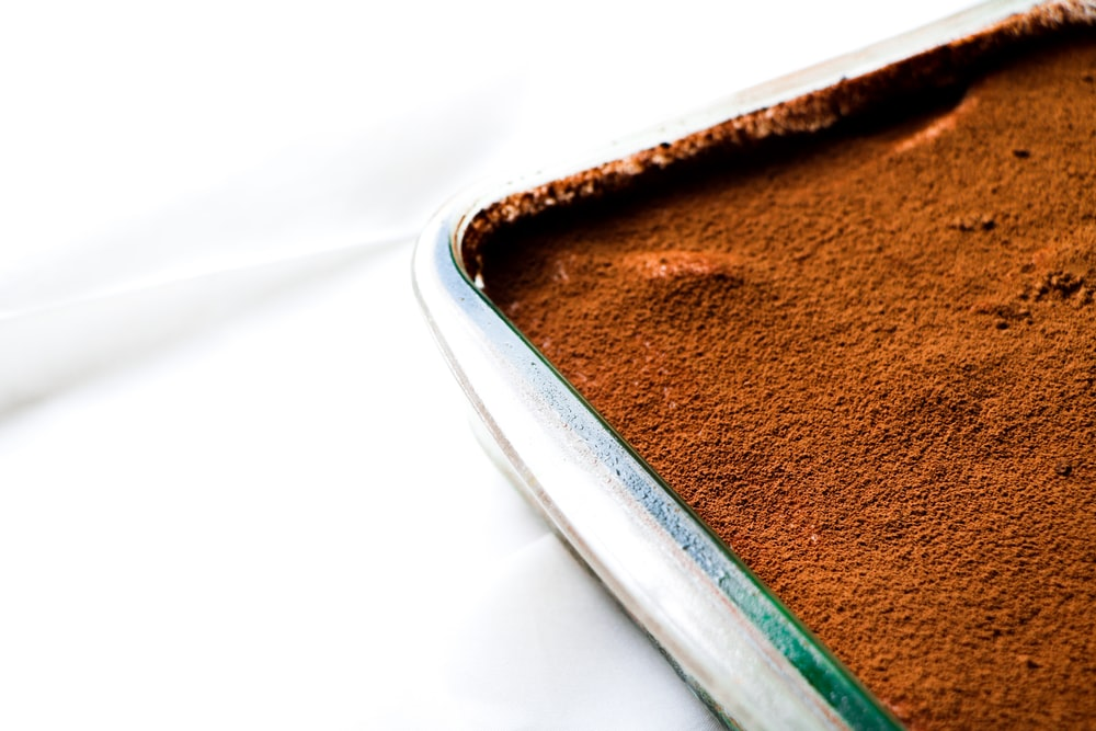 brown powder in stainless steel tray
