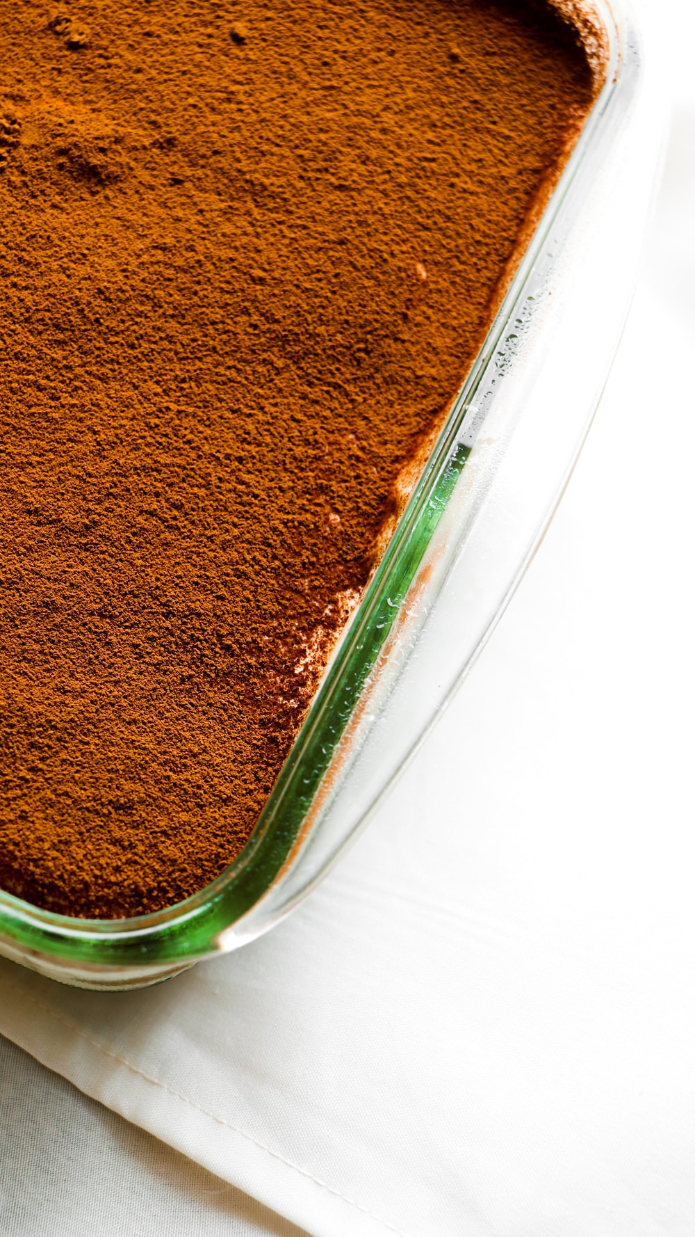 brown powder in clear plastic container
