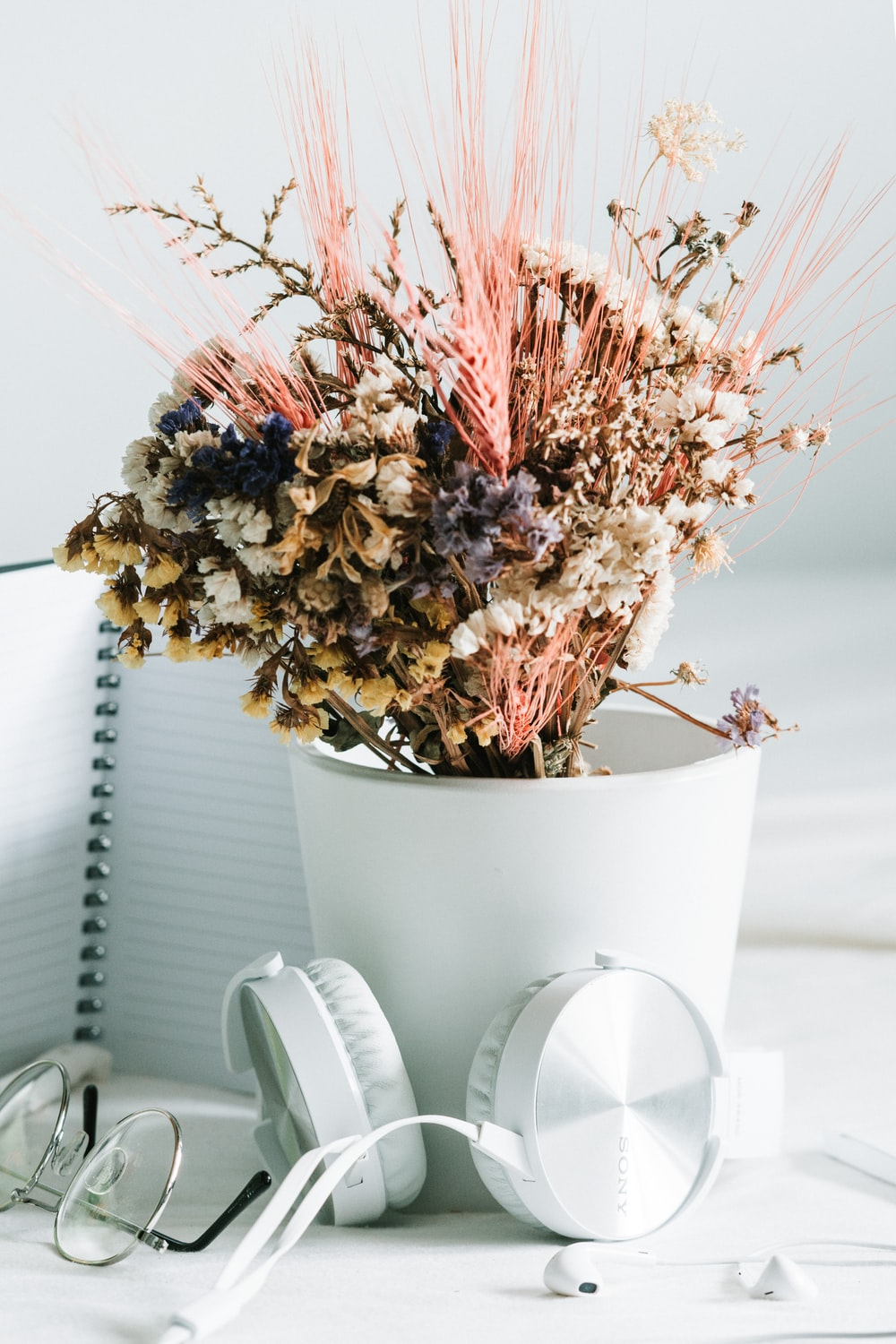 white and pink flowers in white ceramic vase