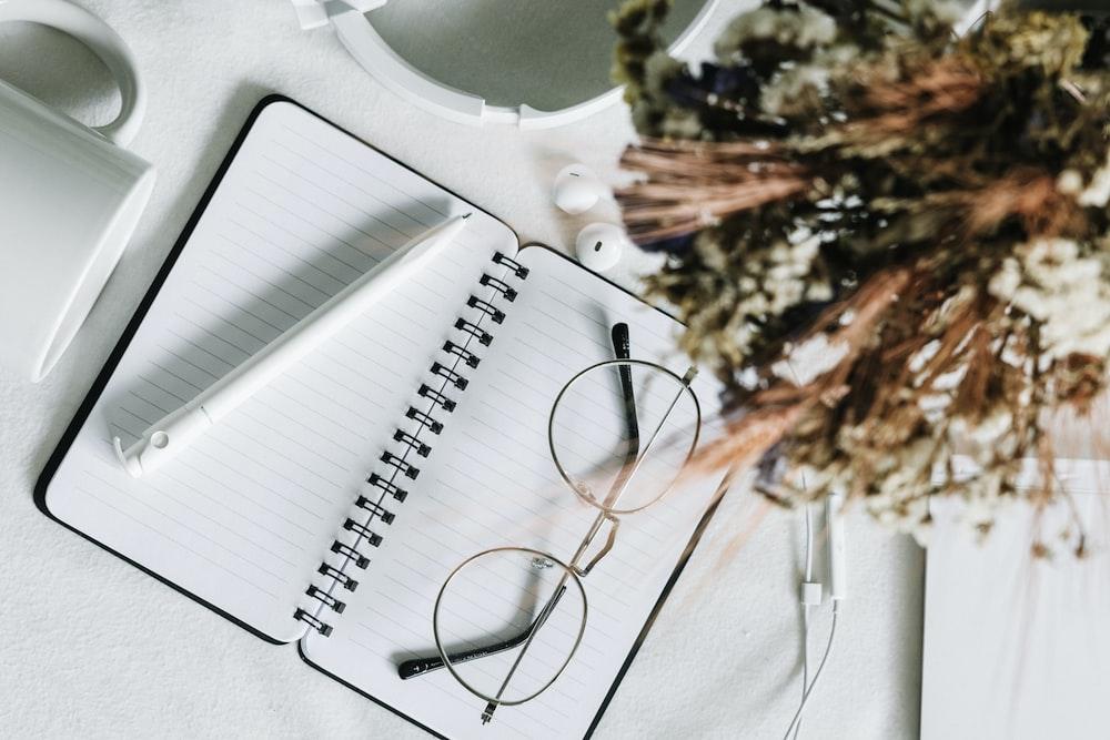 black framed eyeglasses on white plastic table