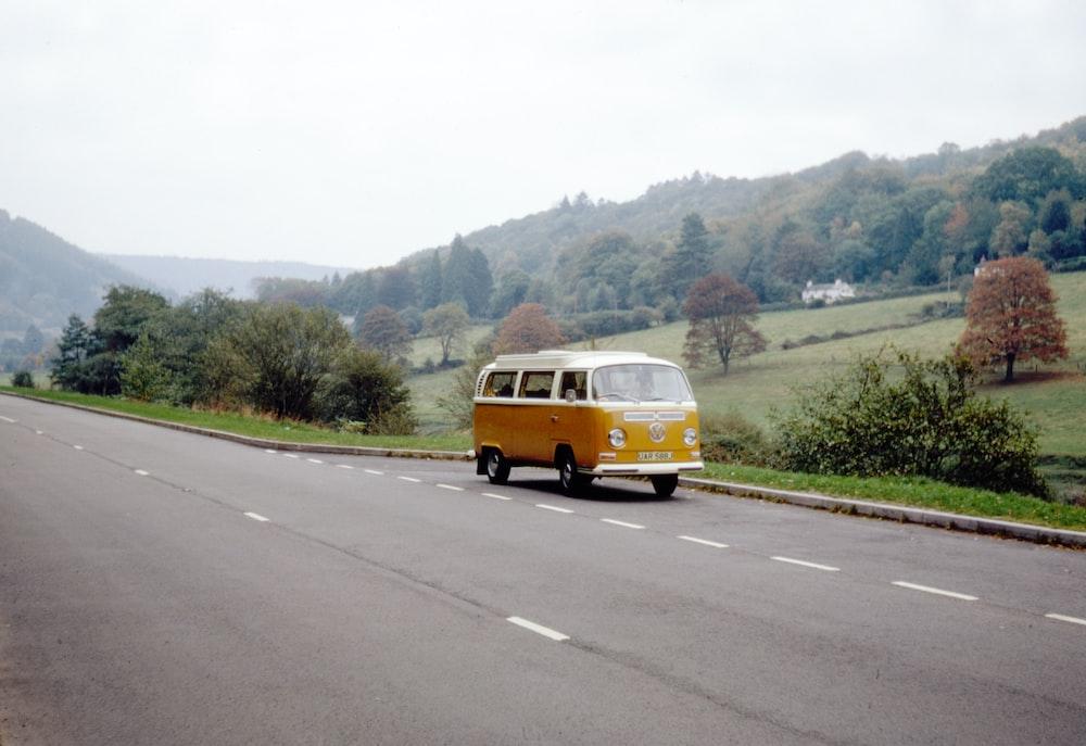 yellow van on road during daytime