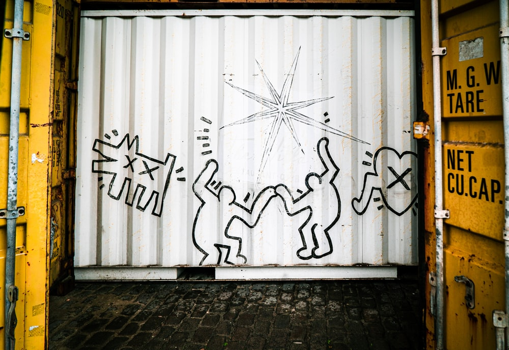 white and black wall with graffiti