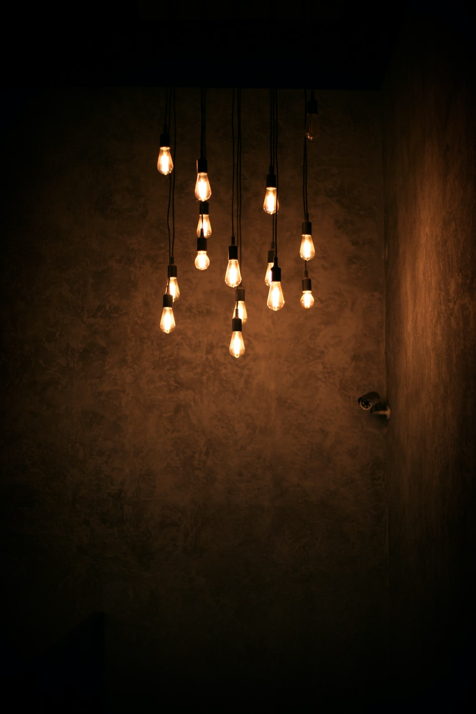 white pendant lamp turned on in room
