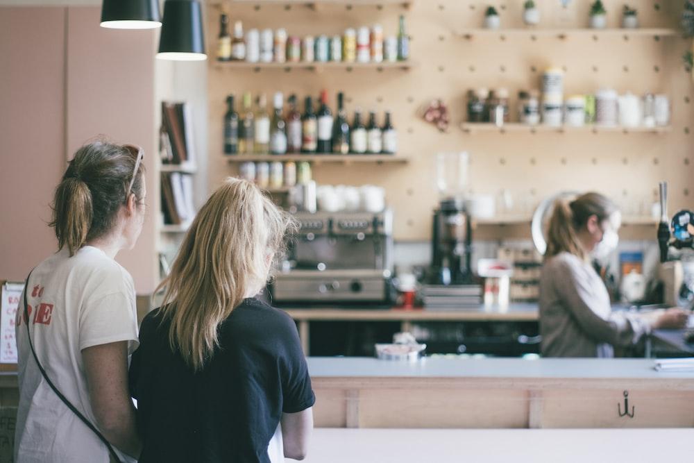 woman in black t-shirt standing near woman in white t-shirt