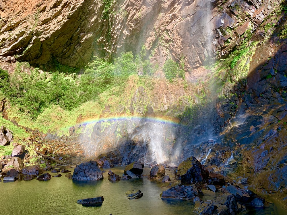 water falls in the middle of rocks