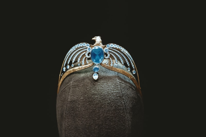 silver and blue gemstone studded crown