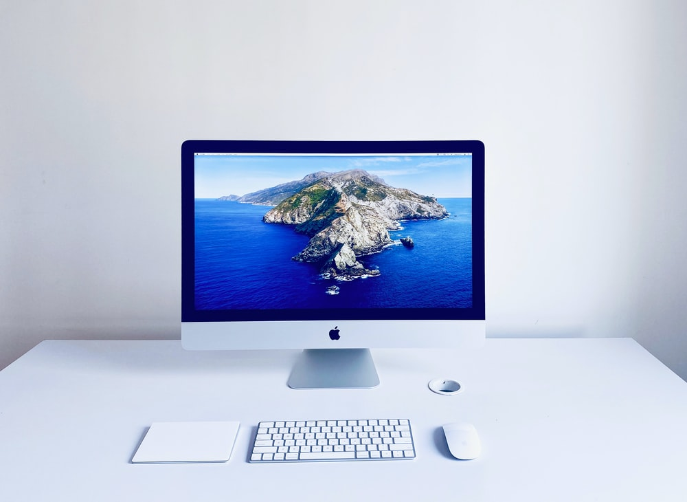 silver imac with apple magic keyboard and magic mouse