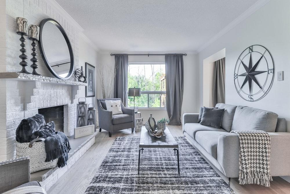 white and black plaid sofa near window